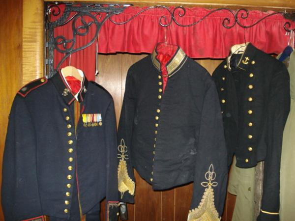 Left to right: 1. WWII Lt Colonel dress blues with pants 2. WWI General dress blues (not sure we have pants) 3. WWII Major dress blues