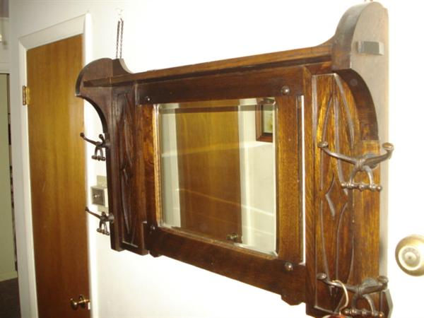 Early 1930s oak wall-mount mirrored coat rack; very nice condition; heavy - weighs aprox 50 pounds